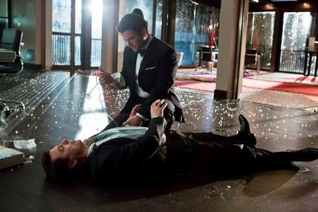 Post a picture of an actor lying on the ground.