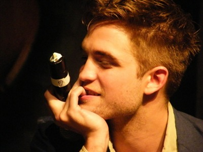 Post a pic of your actor biting his finger.Here is my Robert biting his finger<3