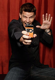 Post a pic of your actor holding a cell phone...