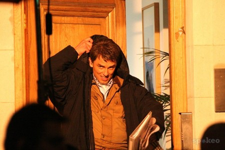 Post a picture of an actor fixing his jacket.