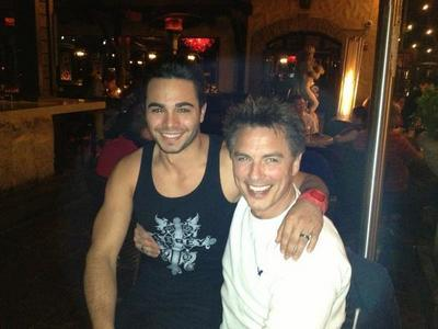 Post a picture of an actor with someone in a vest.
