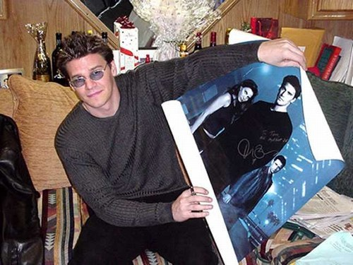 Post a pic of your actor holding a picture/poster of himself...