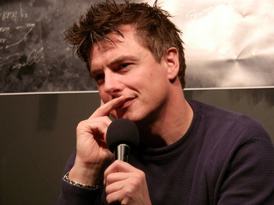 Post a picture of an actor with a microphone.