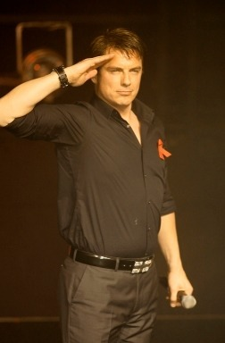 Post a picture of an actor saluting something.