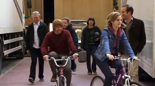 Post a pic of Emma riding a bicycle