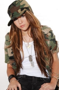 Post a pic of Miley Cyrus wearing hat..