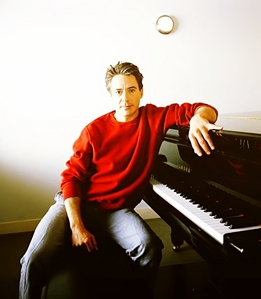Post a picture of an actor with a piano.