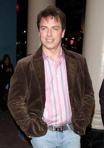 Post a picture of an actor wearing a brown jacket.