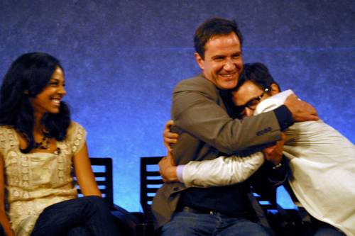 Post a picture of an actor hugging someone?