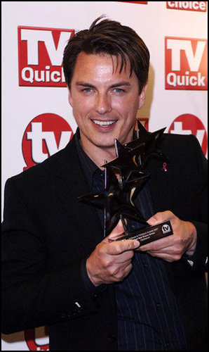 Post a picture of an actor with an award.