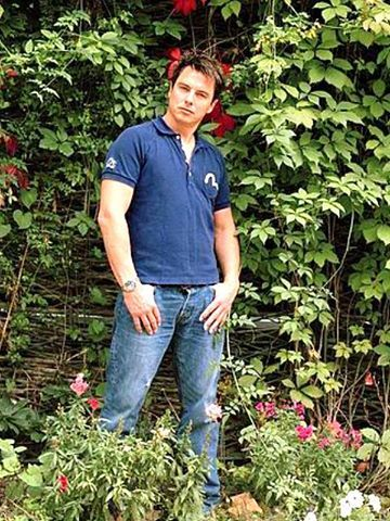 Post a picture of an actor with his t-shirt slightly undone.