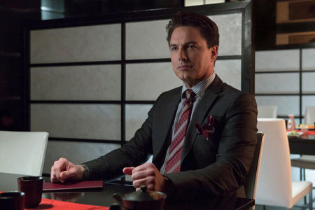 Post a picture of an actor where he sitting at a desk.
