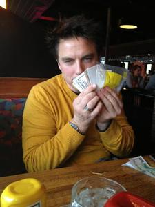 Post a picture of an actor with money.