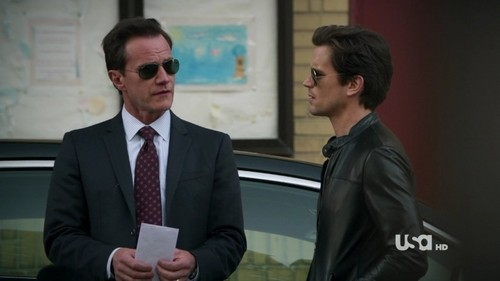 Post a picture of an actor with another actor wearing sunglasses?