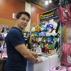 Post a picture of an actor with toys.