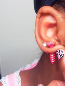 Shiuld I get a third piercing (i already have 2 n a row) ou should I get a cartlige piercing????? Help