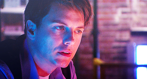 Post a picture of an actor with a purple effect.