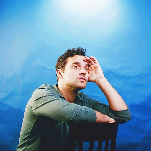 Post a pic of a hot actor with a blue background
