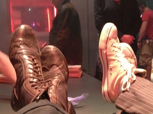 Post a picture of an actor with shoes.