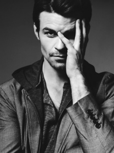 Post a picture of an actor touching his face.