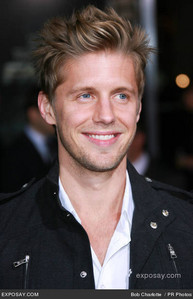 Post a picture of an actor smiling.