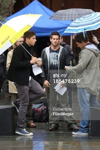 Post a picture of an actor where its raining.