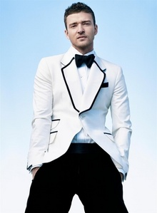 Post a picture of an actor wearing a white suit jacket.