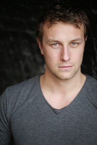 Post a picture of an actor with a tiny bit of stubble.