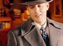 Post a pic of your actor wearing a mantel and hat.