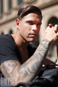 Post a picture of an actor who has tattoo's.