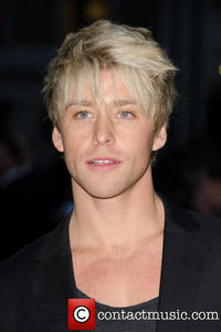 Post a pic of an actor with blonde hair.