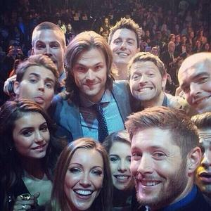 Post a pic of your actor with a group of people.