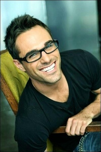 Post an actor wearing glasses.