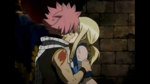 What episode does natsu and Lucy kiss? Do they ever kiss au become a thing?!