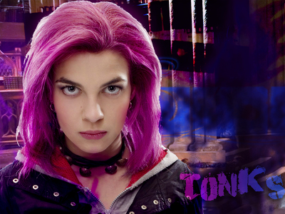 Why does the Order of the phonex book describe Tonks' hair as bubblegum rosado, rosa and in the movie it's purple