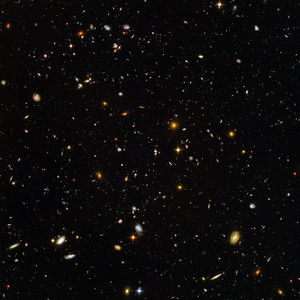 A photograph of the Hubble Ultra Deep Field. Every single little dot of light you see in this picture is an entire galaxy. Over 10,000 in this image alone.