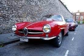 One of the two Alfa Romaneos that chases Con