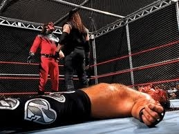 kanes debut first ever hell in a cell match kane tombstones taker and shawn escapes
