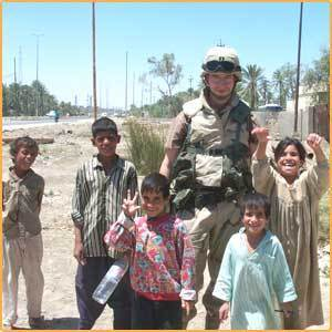 iraqi kids taking pic with american solier