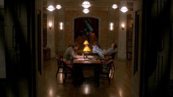 "Sam and Dean in the Men of Letter's secret storehouse in ""Everybody Hates Hitler"""