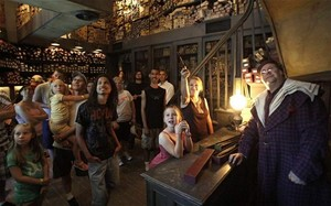 Harry Potter fans enjoy Olivander's Wand boutique at the wizarding theme park in Orlando