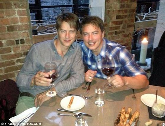 Happy couple: Newlyweds John Barrowman and Scott Gill have been together for 20 years