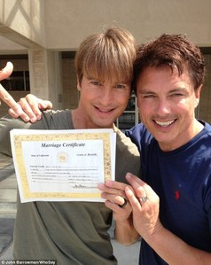 Just married! John Barrowman and Scott Gill mostra off their brand new marriage certificate after tying the knot in California