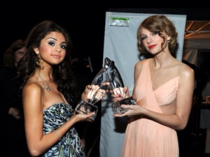 Taylor cepat, swift and Selena Gomez with awards. In future,it could be Tay for acting.
