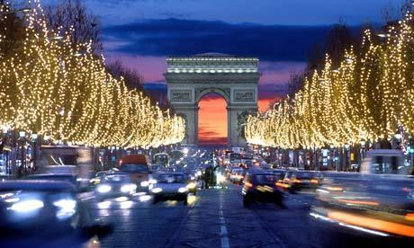 Driving Along The Champs Elysee In A Rented Car