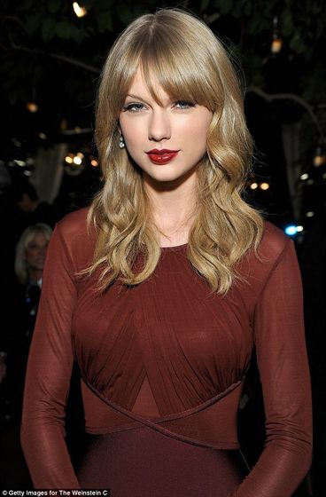Flawless: She wore her ash-blonde hair in soft waves around her face and added a slick of glossy red lipstick