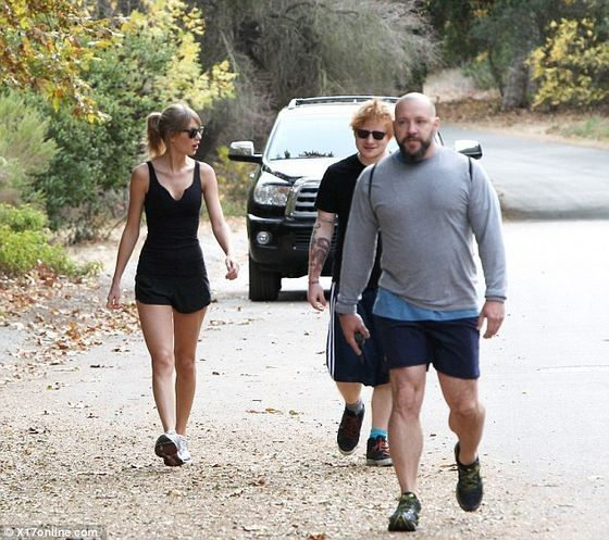 Bony rib cage: The slender singer's low-cut workout top revealed how thin she has gotten as she took to the hills with her BFF