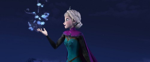 Elsa waved her hand and a flurry of snowflakes burst from her hand.