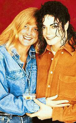 With secondo Wife, Debbie Rowe