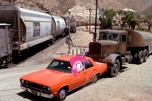 Pinkie's car getting pushed towards the train